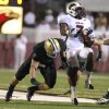 Photo -   Louisiana-Monroe's Jyruss Edwards, right, spins past Baylor's Eddie Lackey during the first half of an NCAA college football game, Friday, Sept. 21, 2012, in Monroe, La. (AP Photo/Waco Tribune Herald, Duane A. Laverty)