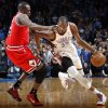 Oklahoma City\'s Kevin Durant (35) tries to get past Chicago\'s Luol Deng (9) during the NBA game between the Oklahoma City Thunder and the Chicago Bulls at Chesapeake Energy Arena in Oklahoma City, Sunday, Feb. 24, 2013. Photo by Sarah Phipps, The Oklahoman