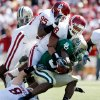 Photo - Jay Finley is brought down by Alan Davis (95) and Travis Lewis (28) in the first half during the college football game between Oklahoma (OU) and Baylor University at Floyd Casey Stadium in Waco, Texas, Saturday, October 4, 2008.   BY STEVE SISNEY, THE OKLAHOMAN ORG XMIT: KOD