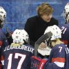 Photo - USA head coach Katey Stone talks with the team during a break in the third period of the game against Switzerland during the 2014 Winter Olympics women's ice hockey match at Shayba Arena, Monday, Feb. 10, 2014, in Sochi, Russia. (AP Photo/J. David Ake)