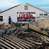 Dune fencing and sand cover the boardwalk in Point Pleasant Beach, N.J., on Thursday, Nov. 1, 2012. The massive storm battered boardwalks and amusement parks up and down the Jersey shore. (AP Photo/Wayne Parry)