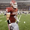 OU\'s Ryan Reynolds walks off the field after OU\'s 14-13 loss in the college football game between the Brigham Young University Cougars (BYU) and the University of Oklahoma Sooners (OU) at Cowboys Stadium in Arlington, Texas, Saturday, September 5, 2009. By Bryan Terry, The Oklahoman