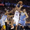 Oklahoma City\'s Kevin Martin (23) drives past Denver\'s Andre Iguodala (9) and JaVale McGee (34) during the NBA basketball game between the Oklahoma City Thunder and the Denver Nuggets at the Chesapeake Energy Arena on Wednesday, Jan. 16, 2013, in Oklahoma City, Okla. Photo by Chris Landsberger, The Oklahoman