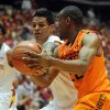 Oklahoma State\'s Markel Brown and Iowa State\'s Chris Babb battle for the ball during 1st half at Hilton Coliseum Wednesday, March 6, 2013, in Ames, Iowa. Photo by Nirmalendu Majumdar/Ames Tribune