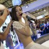 In this May 24, 2012 photo, Gan Lulu performs at a kitchen and toilet equipments expo in Shanghai, China. Regulators suspended a Chinese broadcaster Friday, Nov. 30, 2012, after an unaired segment of a TV game show was leaked online showing a raucous shouting match about nudity between spectators and a woman who calls her daughter the next Lady Gaga. The six-minute clip, still available on YouTube, shows Gan as well audience members and the model\'s mother shouting and swearing after one spectator asks whether Gan\'s risque images have undermined China\'s morality. (AP Photo) CHINA OUT