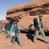 Photo - In this photo taken on March 11, 2014, Volunteers with Utah Museum of Natural History hike overland with equipment to to fossil site near Canyonlands National Park in San Juan County, Utah. (AP Photo/The Salt Lake Tribune, Al Hartmann )  DESERET NEWS OUT; LOCAL TV OUT; MAGS OUT