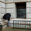 A woman protects herself from a light rain during a break outside the south side of the Oklahoma state Capitol in Oklahoma City on Wednesday, Sept. 8, 2010. Photo by John Clanton, The Oklahoman