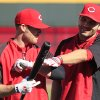 Cincinnati Reds\' Joey Votto, right, jokes with Zack Cozart during batting practice prior to Game 3 of the National League division baseball series against the San Francisco Giants, Tuesday, Oct. 9, 2012, in Cincinnati. (AP Photo/Al Behrman)