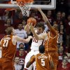 Oklahoma Sooner Ryan Spangler (00) rebounds between Texas Longhorn\'s Connor Lammert (21), Damarcus Croaker (5) and Cameron Ridley (55) in the second half as the University of Oklahoma Sooners (OU) men defeat the Texas Longhorns (TU) 77-65 in NCAA, college basketball at The Lloyd Noble Center on Saturday, March 1, 2014 in Norman, Okla. Photo by Steve Sisney, The Oklahoman
