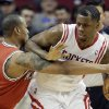 Photo - Milwaukee Bucks' Caron Butler, left, tries to steal the ball from Houston Rockets' Terrence Jones during the second quarter of an NBA basketball game, Saturday, Jan. 18, 2014, in Houston. (AP Photo/David J. Phillip)