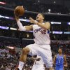 Los Angeles Clippers forward Blake Griffin (32) shoots against the Oklahoma City Thunder in the first half of an NBA basketball game in Los Angeles, Sunday, March 3, 2013. The Thunder won 108-104. (AP Photo/Reed Saxon) ORG XMIT: LAS108