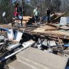Concrete steps are no longer attached to the front of the Lowery family\'s tornado damaged mobile home in Century, Fla., Tuesday, Feb. 16, 2016. (AP Photo/Michael Snyder)