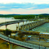 Photo - As the longest bridge ever built for pedestrians and bicycles, the Big Dam Bridge completes a loop with multi-use trails on both banks of the Arkansas River and more pedestrian bridges downtown. PHOTO PROVIDED.