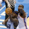 Memphis\' Zach Randolph (50) goes to the basket past Oklahoma City\'s Kendrick Perkins (5) during Game 5 in the first round of the NBA playoffs between the Oklahoma City Thunder and the Memphis Grizzlies at Chesapeake Energy Arena in Oklahoma City, Tuesday, April 29, 2014. Photo by Nate Billings, The Oklahoman
