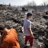 Casey Strahan, lower left, and Logan Renner, 17, lost homes in the wildfire. Residents in Luther were allowed to return to the their homes early Saturday, Aug. 4, 2012, after they fled a rapidly moving wildfire yesterday that consumed at least seven structures on South Dogwood Street, leaving smoldering ashes where family homes once stood. Photo by Jim Beckel, The Oklahoman.