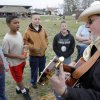 Jim Garling, from Guthrie, teaches some kids a cowboy song at the 6th annual Choctaw Land Run Festival, April 17, 2009. Photo By David McDaniel, The Oklahoman