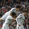 Photo - Real's Gareth Bale, right, celebrates his goal with teammates during a Spanish La Liga soccer match between Real Madrid and Elche at the Santiago Bernabeu stadium in Madrid, Spain, Saturday, Feb. 22, 2014. (AP Photo/Andres Kudacki)