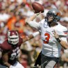OSU quarterback Brandon Weeden passes during the Cowboys\' 30-29 win over Texas A&M on Saturday. Photo by Nate Billings, The Oklahoman