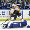 Photo - Tampa Bay Lightning defenseman Radko Gudas (7), of the Czech Republic, slides across the ice, knocking the puck away from Philadelphia Flyers right wing Wayne Simmonds (17) during the first period of an NHL hockey game Thursday, April 10, 2014, in Tampa, Fla. (AP Photo/Chris O'Meara)