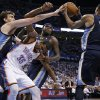 Oklahoma City\'s Kevin Durant (35) gets caught between Memphis\' Marc Gasol (33), Zach Randolph (50) and Mike Conley (11) as he goes for the ball during Game 5 in the second round of the NBA playoffs between the Oklahoma City Thunder and the Memphis Grizzlies at Chesapeake Energy Arena in Oklahoma City, Wednesday, May 15, 2013. Memphis won 88-84. Photo by Bryan Terry, The Oklahoman