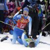 Photo - Finland's Iivo Niskanen, top, and Sami Jauhojaervi celebrate after winning the gold medal in the cross-country team sprint competitions at the 2014 Winter Olympics, Wednesday, Feb. 19, 2014, in Krasnaya Polyana, Russia. (AP Photo/Lee Jin-man)