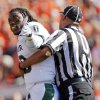 Baylor\'s Robert Griffin III (10) is pulled away from OSU players by an official after a scuffle in the first quarter during a college football game between the Oklahoma State University Cowboys (OSU) and the Baylor University Bears (BU) at Boone Pickens Stadium in Stillwater, Okla., Saturday, Oct. 29, 2011. Photo by Nate Billings, The Oklahoman