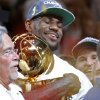 Miami\'s LeBron James holds the Larry O\'Brien NBA Championship Trophy during Game 5 of the NBA Finals between the Oklahoma City Thunder and the Miami Heat at American Airlines Arena, Thursday, June 21, 2012. Oklahoma City lost 121-106. Photo by Bryan Terry, The Oklahoman