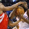Oklahoma City\'s DJ White gets a defensive rebound in front of Houston\'s Kyle Lowry during their NBA basketball game at the OKC Arena in downtown Oklahoma City on Wednesday, Nov. 17, 2010. Photo by John Clanton, The Oklahoman