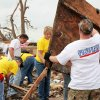 Volunteers from two different groups, Mormon Helping Hands and Operation Blessing International, help a Moore resident after a tornado destroyed her home May 20. Photo provided by Mormonnewsroom.org.