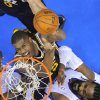 Utah Jazz forward Derrick Favors, left, puts up a shot as Los Angeles Clippers center Ronny Turiaf defends during the first half of an NBA basketball game, Sunday, Dec. 30, 2012, in Los Angeles. (AP Photo/Mark J. Terrill)