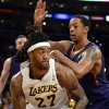 Photo - Los Angeles Lakers forward Jordan Hill (27) battles Phoenix Suns forward Channing Frye, back right, in the first half of an NBA basketball game, Sunday, March 30, 2014, in Los Angeles.(AP Photo/Gus Ruelas)
