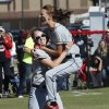 Photo - Hilldale's Casady Mills, right, leaps into the arms of the third baseman McKensie Plant as they defeat Bethel 7-0 in the State 4A Softball Championship game on Saturday, Oct. 19, 2013 in Shawnee, Okla.  Photo by Steve Sisney, The Oklahoman