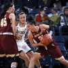 Photo - Boston College guard Kristen Doherty, right, drives around Notre Dame guard Kayla McBride as Boston College forward Katie Zenevitch, left, sets a pick in the first half of an NCAA college basketball game, Thursday, Jan. 9, 2014 in South Bend, Ind. (AP Photo/Joe Raymond)