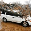 WINTER / COLD / WEATHER / ICE STORM / DAMAGE / AFTERMATH: A vehicle hit by a falling tree at the intersection of NW 41, Harvey Place, and Harvey Parkway in the Crown Heights housing addition in Oklahoma City Monday, Dec. 10, 2007. The people stopped to look at ice-damaged trees when the rest of this tree fell on them. By Paul B. Southerland, The Oklahoman ORG XMIT: KOD
