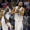 Charlotte Bobcats\' Jeffery Taylor, right, and Michael Kidd-Gilchrist, left, react after defeating the Toronto Raptors in an NBA basketball game in Charlotte, N.C., Wednesday, Nov. 21, 2012. The Bobcats won 98-97. (AP Photo/Chuck Burton)