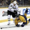 Nashville Predators center Mike Fisher (12) clears the puck away from Dallas Stars left wing Brenden Morrow (10) in the first period of an NHL hockey game on Monday, Feb. 25, 2013, in Nashville, Tenn. (AP Photo/Mark Humphrey)
