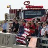 First responders stand on an Interstate 35 overpass to honor two firefighters being transferred from a hospital in Waco, Texas to Hillsboro, Texas Saturday, April 20, 2013, three days after they were injured in an explosion at a fertilizer plant in West, Texas. The massive explosion at the West Fertilizer Co. Wednesday night killed 14 people and injured more than 160. (AP Photo/Charlie Riedel)