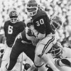 Oklahoma's Thomas Lott, back, watches teammate Kenny King run with the ball after giving him a handoff during a 1978 victory over Oklahoma State.' Photo taken by Doug Hoke. Photo taken 11-18-1978. Dough Hoke - Staff Photo