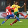 Photo - Cameroon's Gaetan Mbong, right, and Paraguay 's  Rojas Jorge  challenge for the ball during their friendly soccer match in Kufstein, Austrian province of Tyrol, on Thursday, May 29. 2014. (AP Photo/Kerstin Joensson)