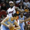 Denver Nuggets forward Danilo Gallinari looks for an opening past Miami Heat forward LeBron James (6) during the first half of an NBA basketball game, Saturday, Nov. 3, 2012 in Miami. (AP Photo/Wilfredo Lee)