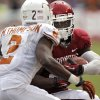 OU\'s Damien Williams (26) looks to get past UT\'s Mykkele Thompson (2) during the Red River Rivalry college football game between the University of Oklahoma (OU) and the University of Texas (UT) at the Cotton Bowl in Dallas, Saturday, Oct. 13, 2012. Photo by Chris Landsberger, The Oklahoman