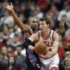 Photo - Chicago Bulls forward Mike Dunleavy, right, looks to pass the ball against Charlotte Bobcats guard Gerald Henderson, left, during the first half of an NBA basketball game in Chicago, Saturday, Jan. 11, 2014. (AP Photo/Kamil Krzaczynski)