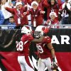 Photo - Arizona Cardinals' Rashad Johnson (49) celebrates his interception returned for a touchdown against the Detroit Lions with teammate Greg Toler (28) during the first half in an NFL football game on Sunday  Dec. 16, 2012, in Glendale, Ariz.(AP Photo/Ross D. Franklin)