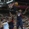 United States\' LeBron James, right, grabs a rebound as teammate Kobe Bryant blocks out Argentina\'s Luis Scola during a men\'s semifinals basketball game at the 2012 Summer Olympics, Friday, Aug. 10, 2012, in London. (AP Photo/Charles Krupa)