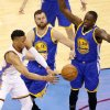 Russell Westbrook passes the ball past Golden State's Andrew Bogut (left) and Draymond Green in Game 3. (Photo by Sarah Phipps)