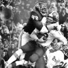 Cowboy quarterback Charlie Weatherbie is about to lose his helmet and his head may not be too secure after a smothering tackle by Lee Roy Selmon during the Bedlam college football game between OU and OU on Nov 30, 1974. OU won, 44-13. Staff photo by Bob Albright