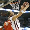 Oklahoma\'s Taylor Griffin (32) drives to the basket past Syracuse\'s Paul Harris (11) during the second half of the NCAA Men\'s Basketball Regional at the FedEx Forum on Friday, March 27, 2009, in Memphis, Tenn. PHOTO BY CHRIS LANDSBERGER, THE OKLAHOMAN