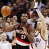 Portland\'s Greg Oden (52) looks to pass the ball away from the defense of Oklahoma City\'s Nick Collison (4) during the NBA basketball game between the Oklahoma City Thunder and the Portland Trail Blazers at the Ford Center in Oklahoma City, Friday, February 6, 2009. BY NATE BILLINGS, THE OKLAHOMAN