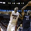 Charlotte Bobcats\' Al Jefferson (25) takes a pass from a teammate over Miami Heat\'s Udonis Haslem (40) during the second half in Game 1 of an opening-round NBA basketball playoff series on Sunday, April 20, 2014, in Miami. The Heat defeated the Bobcats 99-88. (AP Photo/Lynne Sladky)