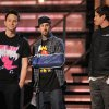 Mark Hoppus, left, Travis Barker, and Tom DeLonge of Blink 182 speak on stage at the 51st Annual Grammy Awards on Sunday, Feb. 8, 2009, in Los Angeles. (AP Photo/Mark J. Terrill)